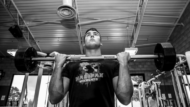 Lance Cpl. Austin Enders, intelligence specialist, 15th Marine Expeditionary Unit, works out aboard Camp Pendleton, Calif., March 27, 2014. Enders, 19, is from Halifax, Pa. and enlisted in the Marine Corps on Sept. 11, 2012 (U.S. Marine Corps photo by Cpl. Emmanuel Ramos/Released)