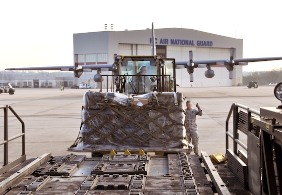 U.S. Air Force Tech. Sgt. Phillip Harrell and Staff Sgt. Jesse Huneycutt, 145th Logistics Readiness Squadron, Air Transportation Specialists, use a K-Loader and 10k All Terrain forklift to load pallets containing dental and medical supplies onto a C-130 Hercules aircraft at the North Carolina Air National Guard base, Charlotte Douglas Intl. airport, February 20, 2014. The 145th Airlift Wing prepares a flight bound for Louisiana in support of Cajun Care 2014, a Department of Defense, Innovative Readiness Training mission designed to provide U.S. military medical professionals invaluable training as well as provide health care options to a medically underserved community. (U.S. Air National Guard photo by Master Sgt. Patricia F. Moran, 145th Public Affairs/Released)