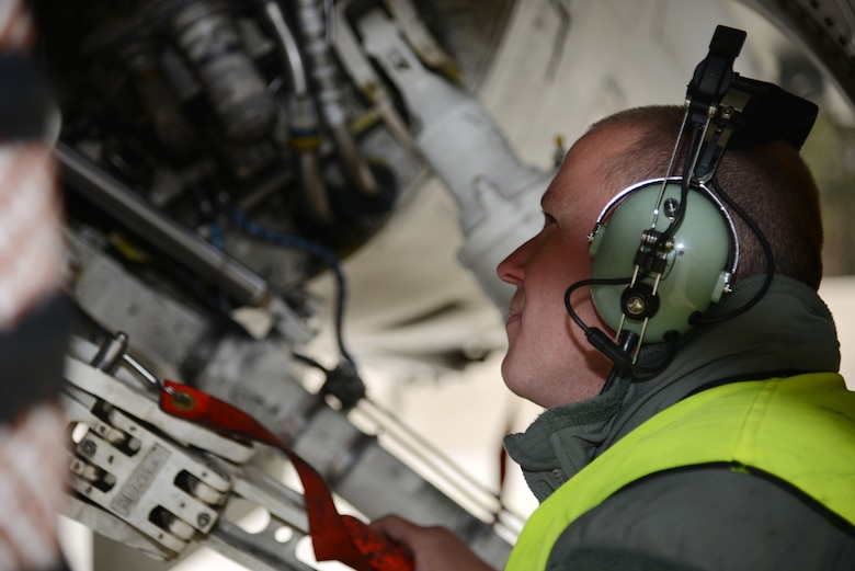 Staff Sgt. Ryan Galler, 555th Air Maintenance Unit crew chief, Aviano Air Base, Italy, from Orlando, Fla., prepares a U.S. F-16 Fighting Falcon fighter aircraft to fly with the Polish air force April 1, 2014, at Łask Air Base, Poland. Polish and U.S. personnel are training together to enhance bilateral defense ties and ready air forces demonstrating an enduring partnership to the NATO mission. (U.S. Air Force photo by 2nd Lt. Katrina Cheesman/Released)