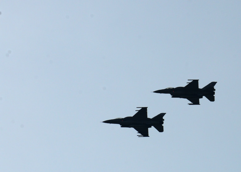 Two Polish air force F-16 Fighting Falcon fighter aircraft fly in formation during a training mission, April 1, 2014, over Łask Air Base, Poland. Poland continues to build its relationship with the U.S. as both nations' air forces train in a joint theater capacity for the first time since the arrival of 31st Fighter Wing aircraft and personnel from Aviano Air Base, Italy. (U.S. Air Force photo/Airman 1st Class Ryan Conroy/Released)