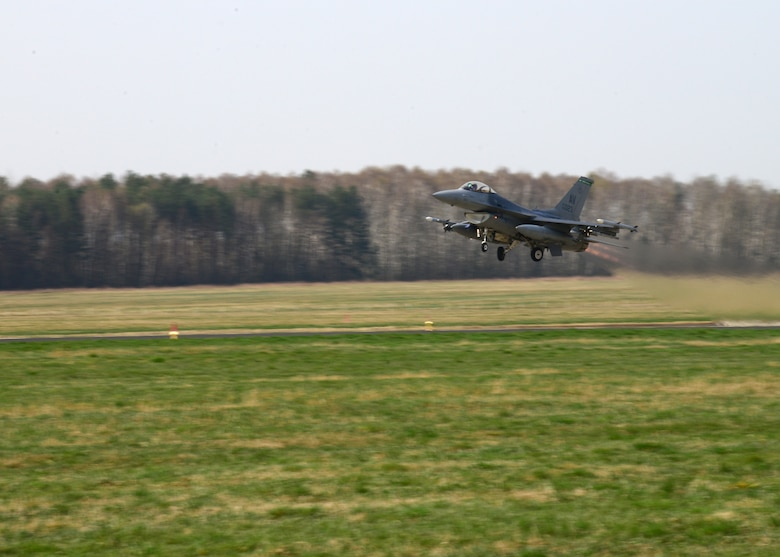 A 555th Fighter Squadron F-16 Fighting Falcon fighter aircraft from Aviano Air Base's 31st Fighter Wing takes off for a joint-theater training mission with Polish air forces, April 1, 2014, from Łask Air Base, Poland. Poland continues to build its relationship with the U.S. as both nations' air forces integrate their capabilities through training sorties in a joint theater capacity for the first time since the arrival of 31st Fighter Wing aircraft and personnel. (U.S. Air Force photo/Airman 1st Class Ryan Conroy/Released)