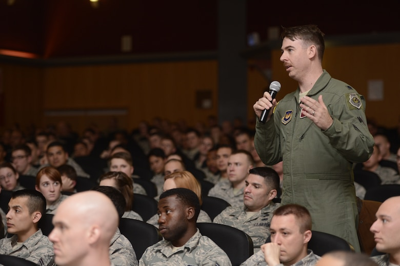 U.S. Air Force Lt. Col. Benjamin Busch, 52nd Operations Support Squadron commander from San Diego, asks U.S. Air Force Chief Master Sgt. James Davis, U.S. Air Forces in Europe and Air Forces Africa command chief, a question during 'Inside the Chief's Office' March 28, 2014 at Spangdahlem Air Base, Germany.  Davis oversees the readiness, training, professional development and effective utilization of Europe and Africa's U.S. enlisted Airmen. (U.S. Air Force photo by Staff Sgt. Christopher Ruano/Released)