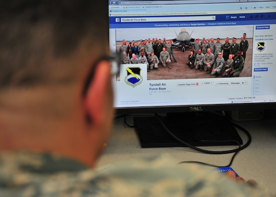 Airman 1st Class Solomon A. Cook, 325th Fighter Wing Public Affairs photojournalist, checks Facebook April 1 to simulate social networking in uniform.(U.S. Air Force photo by Airman 1st Class Sergio A. Gamboa)