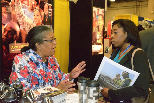 Nashville, TN - U.S. Army Corps of Engineers Nashville District Chief of Equal Employment Opportunity, Carol Haynes talks with Vanessa Web an engineering student from Texas Tech University. Web was attending the 40th annual  National Society of Black Engineers Conference at the Gaylord Opryland Hotel & Convention Center in Nashville, Tenn, March 26-29, 2014. Corporations from around the United States were represented at the conference.