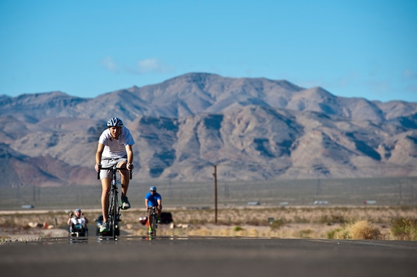 Cody Caraker cycles Feb. 27, 2014, through Nellis Air Force Base, Nev., during an Air Force Wounded Warrior Adaptive Sports Camp. The 2014 Warrior Games Selection Camp will begin April 7 with 100 athletes coming from across the United States to compete for the 40 positions on the U.S. Air Force team. Caraker is an adaptive sports camp participant. (U.S. Air Force photo/Senior Airman Christopher Tam)