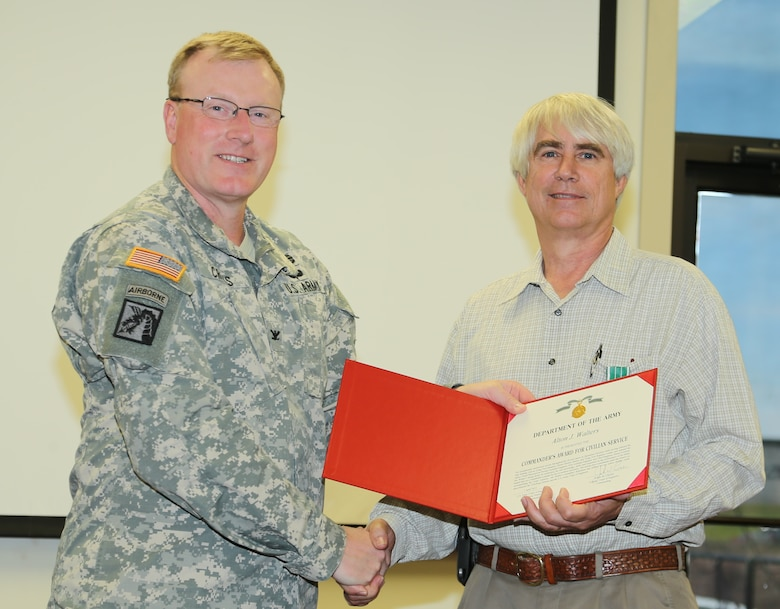 Walters is shown in photo accepting Commander's Award for Civilian Service from COL John W. Cross, Commander of the Vicksburg District.