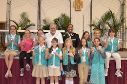 ALBUQUERQUE, N.M., -- Lt. Col. Gant, commander, Albuquerque District, U.S. Army Corps of Engineers Corps, and Kurt Wagener, field engineer for the Albuquerque Metropolitan Arroyo Flood Control Authority with the Girl Scout Troop #35 as they display their new badges, March 22, 2014.