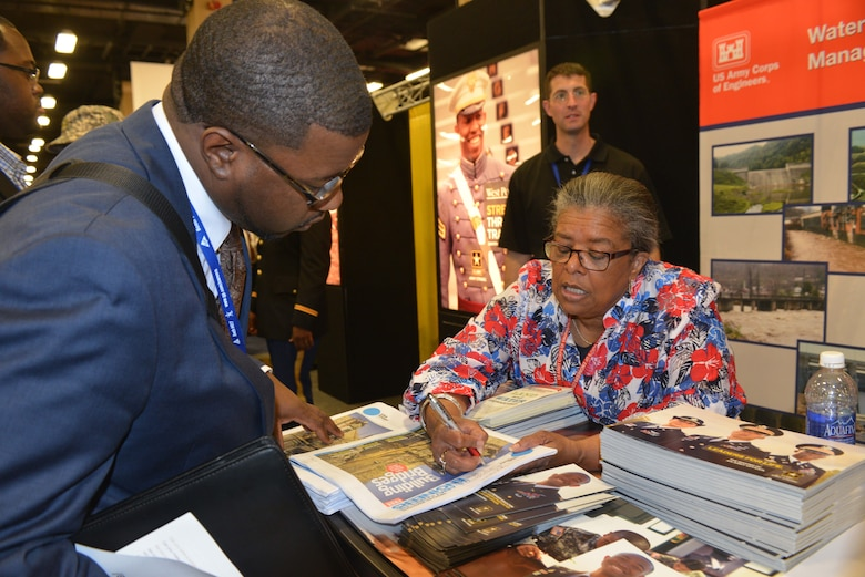 Nashville, TN  - U.S. Army Corps of Engineers Nashville District Chief of Equal Employment Opportunity, Carol Haynes answers questions for a student attending the 40th annual  National Society of Black Engineers Convention at the Gaylord Opryland Hotel & Convention Center in Nashville, Tenn, March 26, 2014.  More than 8,000 students attended the convention.
