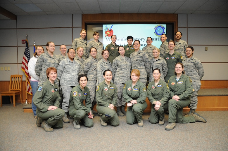 Female members of the 348th Reconnaissance Squadron and 319th Air Base Wing joined forces to set a new record for the longest flight by a military aircraft without air refueling. The record was broken March 29, 2014, with an RQ-4 Global Hawk remaining aloft for 34.3 hours. (U.S. Air Force photo illustration/Staff Sgt. David Dobrydney)