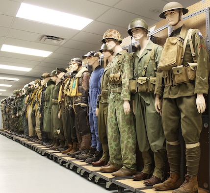 In the Life Science Equipment Laboratory, a row of uniformed mannikens represents all of the eras of accurate uniforms Agile Combat Support keeps on hand for their analysis and forensic-type research.