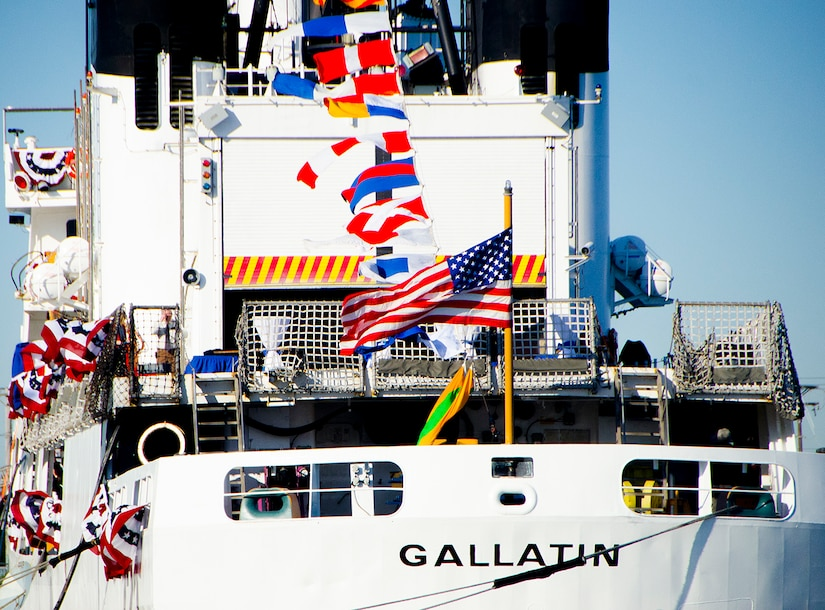 The American flag flies at the stern of United States Coast Guard Cutter Gallatin (WHEC-721), during its decommissioning ceremony March 31, 2014, in Charleston, S.C.  The Gallatin is being replaced by a new National Security Cutter, USCGC Hamilton (WMSL-753).  (U.S. Air Force photo/ Staff Sgt. Aaron Thomasson)