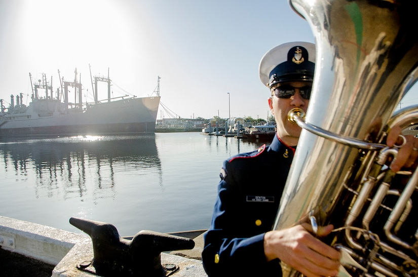 United States Coast Guard Senior Chief Petty Officer Rich Denton, a musician, tunes up before playing at the decommissioning ceremony of United States Coast Guard Cutter Gallatin (WHEC-721), March 31, 2014 in Charleston, S.C.  The Gallatin is being replaced by a new National Security Cutter, USCGC Hamilton (WMSL-753).  (U.S. Air Force photo/ Staff Sgt. Aaron Thomasson)