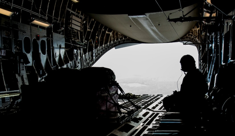 Staff Sgt. Manuel Chacon, 15th Airlift Squadron loadmaster, waits for a heavy pallet to be dropped from a Joint Base Charleston, S.C., C-17 Globemaster III, March 27, 2014. The cargo drops were part of a large formation exercise which provided more than 500 operational and maintenance training objectives and demonstrated the U.S. Air Force's strategic capability. (U.S. Air Force photo/ Airman 1st Class Clayton Cupit)