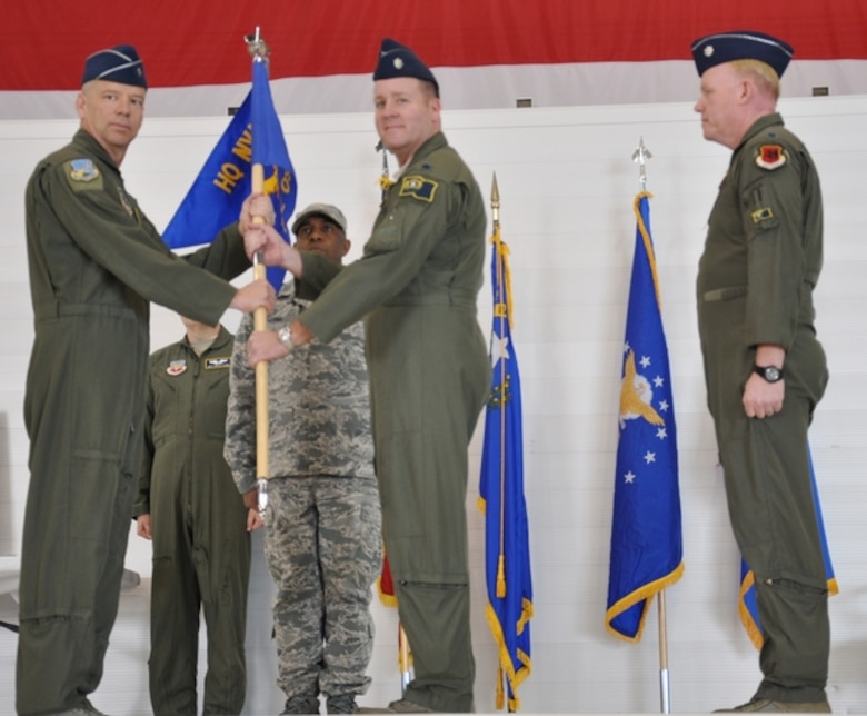 Lt. Col. Walter Reiss III, center, accepts command of the 232nd Operations Squadron from Brig. Gen Davis Snyder, left, at Creech Air Force Base on Mar. 20 while Lt. Col. Warren Rapp, right, views the transfer of the unit's flag of command. Reiss, a 1993 Air Force Academy graduate, was formerly an advisor to the U.S. Air Force Warfare Center on issues related to total force integration and civil aviation activities.