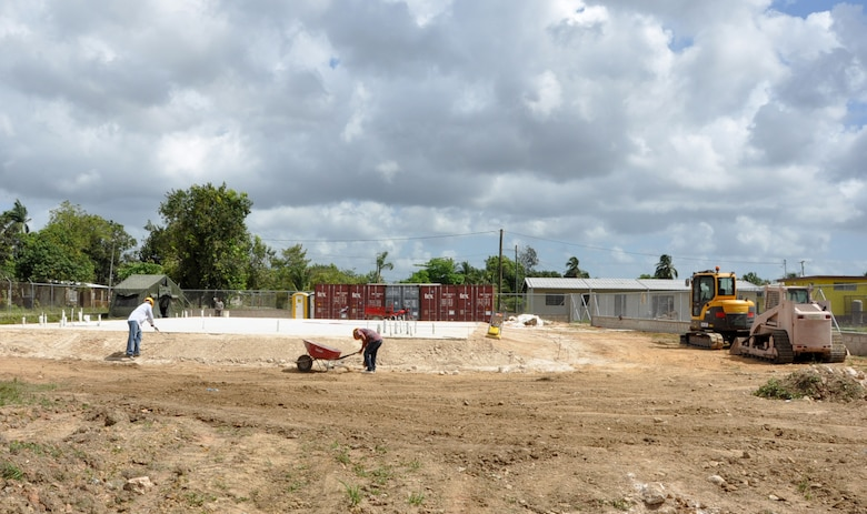 Belizean contractors make final preparations at the Hattieville school construction site March 26, 2014, in Belize City, Belize. Sadie Vernon is one of five construction sites throughout Belize where Belizean Defence Force engineers and U.S. service members will team up to build partnerships and learn from one another. The construction is part of New Horizons Belize 2014, an exercise to enhance BDF and U.S. construction and medical processes. (U.S. Air Force photo by Tech. Sgt. Kali L. Gradishar/Released)