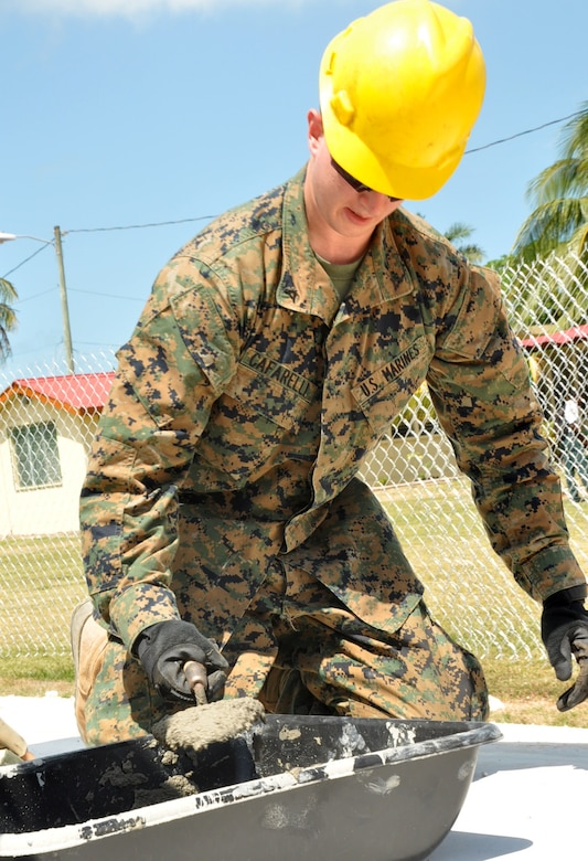 U.S. Marine Corps Lance Cpl. David Cafarelli, Marine Wing Support Squadron 472, prepares a corner of the Edward P. Yorke school construction site to lay block March 31, 2014, in Belize City, Belize. Marines from MWSS-472 will work side by side with engineers from the Belizean Defence Force to provide an additional classroom to the Yorke school. The construction is part of New Horizons Belize 2014, an exercise to build partnerships and learn from one another in construction, as well as medical, realms. (U.S. Air Force photo by Tech. Sgt. Kali L. Gradishar/Released)