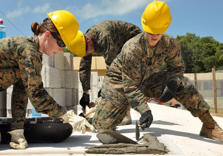 U.S. Marine Corps Cpl. Melissa Baker, left, and Lance Cpl. David Cafarelli, right, Marine Wing Support Squadron 472, prepare a corner of the Edward P. Yorke school construction site to lay block March 31, 2014, in Belize City, Belize. Marines from MWSS-472 will work side by side with engineers from the Belizean Defence Force to provide an additional classroom to the Yorke school. The construction is part of New Horizons Belize 2014, an exercise to build partnerships and learn from one another in construction and medical realms. (U.S. Air Force photo by Tech. Sgt. Kali L. Gradishar/Released)