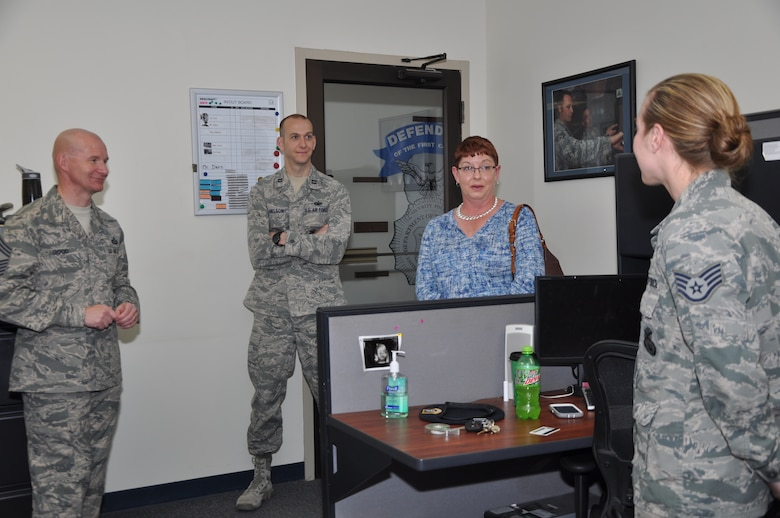 GOODFELLOW AIR FORCE BASE, Texas -- Chief Master Sgt. Thomas F. Good, 17th Training Wing command chief, Capt. James J. Nelson, 17th Security Forces Squadron Commander, and Tennie Good, family member, talk to an Airman about the Air Force at the Security Forces building during an emersion here March 18. Good took charge as the wing's enlisted force leader and wing commander's personal advisor in February. (U.S. Air Force photo/ Airman 1st Class Breonna Veal)
