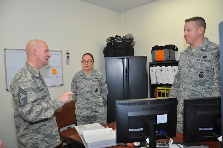 GOODFELLOW AIR FORCE BASE, Texas –Chief Master Sgt. Thomas F. Good, 17th Training Wing command chief, talks with Senior Airman Kadey L. Curtin, 17th Security Forces Squadron Plans and Programs technician and Tech. Sgt. Seth D. Swaboski, 17th SFS Plans and Programs superintendent, during an emersion here March 18. Good asked the Airmen questions about their time in the Air Force. (U.S. Air Force photo/ Airman 1st Class Breonna Veal)