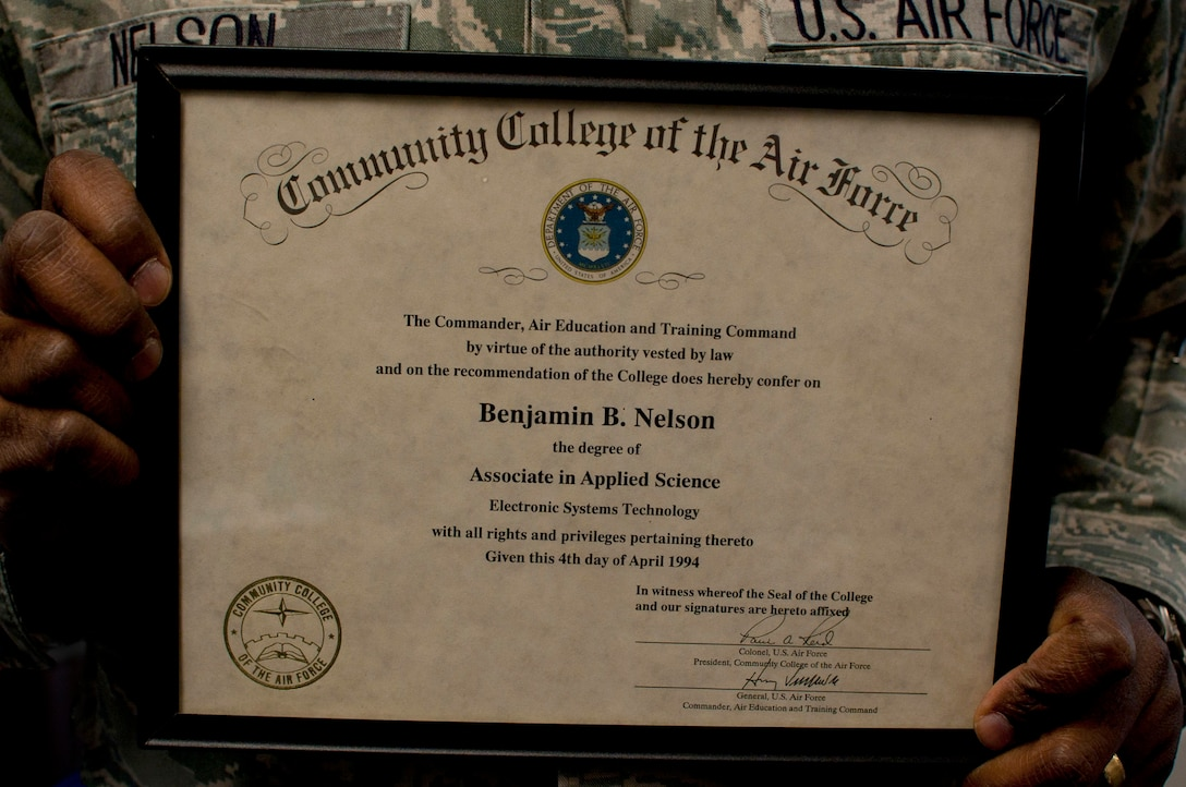 Lt. Col. Benjamin Nelson, Air University deputy communication information officer and communication technical officer, holds the Community College of the Air Force degree he received in 1994. A year later, he completed his bachelor's degree, and commissioned through Officer Training School. (U.S. Air Force photo by Staff Sgt. Natasha Stannard)