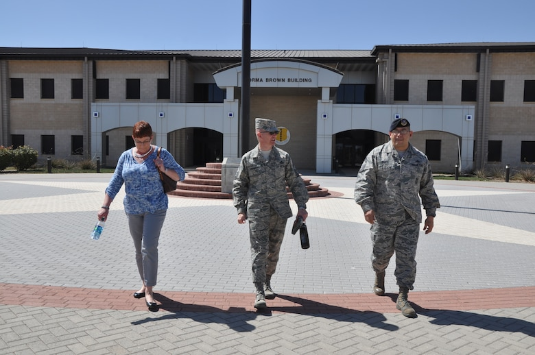 GOODFELLOW AIR FORCE BASE, Texas -- Tennie Good, family member, Chief Master Sgt. Thomas F. Good, 17th Training Wing command chief, and Chief Master Sgt. Jessie Cantu, 17th Security Forces Squadron security forces manager, walk to the 17th SFS building here March 18. Good conducted several emersions within the 17th TRW to meet and greet service members.  (U.S. Air Force photo/ Airman 1st Class Breonna Veal)
