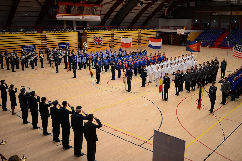 Volleyball teams from six nations form up for the closing ceremony of the Headquarters Allied Air Command Inter-Nation Sports Programme Volleyball Championship tournament in Amsterdam, March 27, 2014. Members from the U.S., Polish, British, German, Dutch and Belgian air forces represented their countries in the volleyball tournament. (U.S. Air Force photo by Senior Airman Gustavo Castillo/Released)