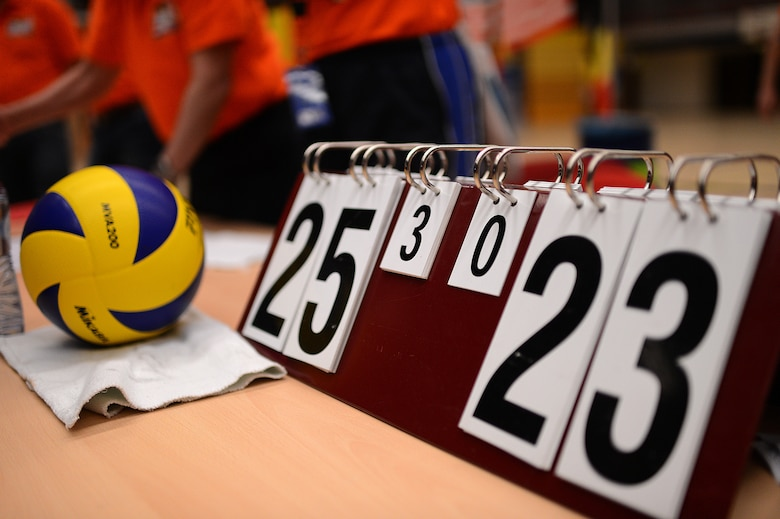 The final score of the U.S. Air Forces in Europe and Air Forces Africa women's volleyball final match rests on the judge's table during a Headquarters Allied Air Command Inter-Nation Sports Programme Volleyball Championship tournament in Amsterdam, March 27, 2014. The women's team took first place for the eighth year in a row after a 3 – 0 match against their German rivals. (U.S. Air Force photo by Senior Airman Gustavo Castillo/Released)