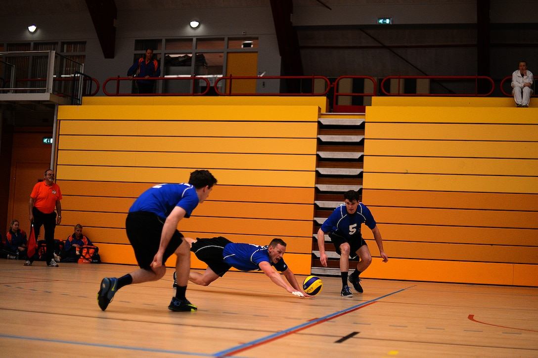 Stuart Sherman, U.S. Air Forces in Europe and Air Forces Africa men's volleyball team outside hitter from Tuscon, Ariz., center, dives for the ball during a Headquarters Allied Air Command Inter-Nation Sports Programme Volleyball Championship match in Amsterdam, March 26, 2014. Sherman received the outstanding sportsmanship award for his actions displayed during the tournament. (U.S. Air Force photo by Senior Airman Gustavo Castillo/Released)