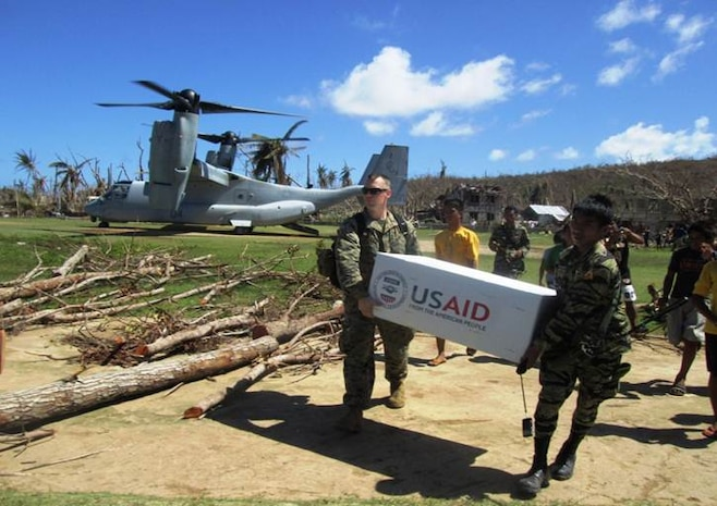 CA Marines work with the support of USAID and the Armed Forces of the Phillipines to deliver emergency supplies to those affected by typhoon Haiyan.