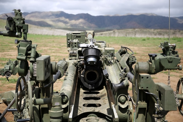 An M777A2 Howitzer sits quietly as Marines await their next fire mission. The M777A2 Howitzer is an asset to artillery units within the Marine Corps. It fires a variety of rounds exceeding 100lbs including white phosphorous, illumination and smoke rounds. The weapon system can be assembled and effectively engaging the enemy minutes after arriving on the battlefield. (U.S. Marine Corps photo by Lance Cpl. Jonathan Boynes/released)