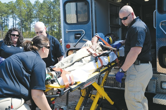 First responders prepare to transport a simulated victim for treatment during the Twisting Thunder 2014 exercise, Tuesday. The two-day destructive-weather exercise was held at Marine Corps Logistics Base Albany.