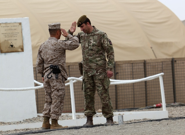 Brigadier James Woodham, right, commander of Task Force Helmand, gives the final salute to Brigadier Gen. Daniel Yoo, commander of Regional Command (Southwest), symbolizing the closure of Task Force Helmand during a merger ceremony for the task force and RC(SW) aboard Camp Bastion, Afghanistan, April 1, 2014. Following eight years of combat operations in Helmand province, the ceremony marked the end of the United Kingdom's military headquarters in southwestern Afghanistan. The functions of the British headquarters element now reside with RC(SW). The task force was established in April 2006 and has conducted 16 rotations since its beginning.