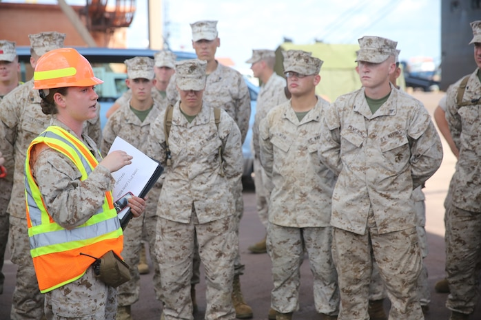 1st Lt. Emily Kay, logistics officer with Logistics Combat Element, Marine Rotational Force – Darwin gives a safety brief to Marines participating in the offload and transportation of MRF-D gear from the USNS 2nd Lt. John P. Bobo to Robertson Barracks and Royal Australian Air Force's Base Darwin, March 31. As of early April, MRF-D will be at full capacity, wasting no time to begin the six-month rotation alongside the ADF and Darwin community for the extent of the Dry Season.