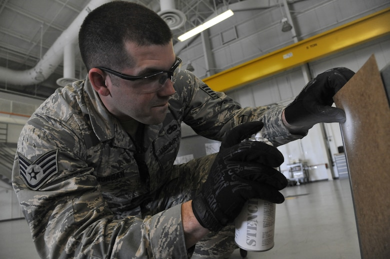 U.S. Air Force Staff Sgt. Kenneth Morgan, 509th Munitions Squadron conventional maintenance section crew chief, marks the amount of KMU-556 tail kits in a storage container. The 509th Munitions Squadron conventional maintenance section is responsible for building, testing and maintaining munitions for different aircraft. (U.S. Air Force photo by Airman 1st Class Keenan Berry/Released)