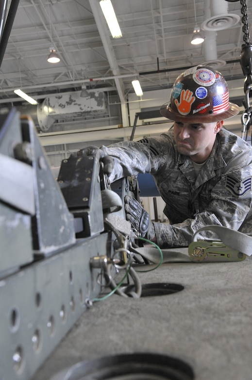 U.S. Air Force Staff Sgt. William Park, 131st Maintenance Squadron Munitions Flight conventional maintenance section crew chief, ensures the MHU-110 trailer is ready for an assembled munitions load at Whiteman Air Force Base, Mo., April 1, 2014. The trailer has a rated weight capacity of 15,000 pounds.  (U.S. Air Force photo by Airman 1st Class Keenan Berry/Released)