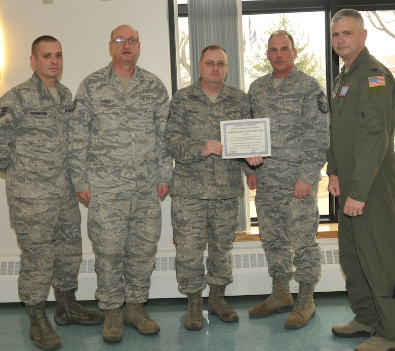 STRATTON AIR NATIONAL GUARD BASE, N.Y. -- Col. Shawn Clouthier (right), 109th Airlift Wing commander, presents (from left) Tech. Sgt. Robert Harrington, Tech. Sgt. Scott Anderson, Master Sgt. Patrick Reimann and Senior Master Sgt. Greg Mihalko with a certificate of recognition March 25, 2014, from Air Mobility Command for outstanding performance during the 109th AW's recent Unit Effectiveness Inspection. The Airmen, of the 109th Communications Flight, received team recognition as part of the Communications Flight Operation Raven Dew Team. Other members of the team not pictured were retired Senior Master Sgt. Jeffrey Lapp, Staff Sgt. Johnny Cope and Senior Airman Daniel Street. (Air National Guard photo by Master Sgt. William Gizara/Released)