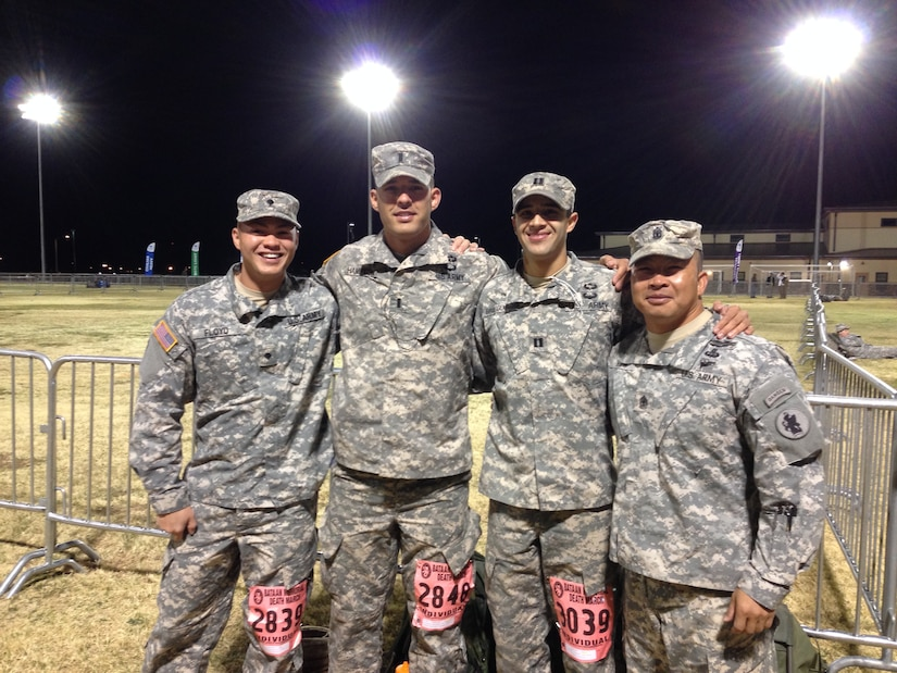 From left to right, U.S. Army Spc. Christopher Floyd,U.S. Army 1st Lt. Spencer Hampton, U.S. Army Capt. Bradley Brueggemann, U.S. Army 1st Sgt. Thinh Huynh at the Bataan Memorial Death March on Sunday March 23, 2014. Four members of Joint Task Force-Bravo's Army Forces Battalion (ARFOR) in Soto Cano Air Base, Honduras, completed the Bataan Memorial Death March on Sunday March 23, 2014 in the White Sands Missile Range, New Mexico. The Bataan Memorial Death March honors a group of World War II heroes, who defended the islands of Luzon, Corregidor and the harbor defense forts of the Philippines in 1942. After being captured by the Japanese forces, these Army, Army Air Corps, Navy, Marines, and National Guard heroes, survived on half or quarter rations and outdated equipment during the 80 mile march.The soldiers were responsible for the defense of the islands of Luzon, Corregidor and the harbor defense forts of the Philippines.