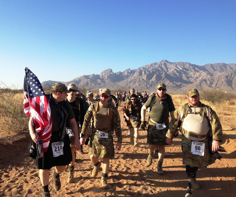 Participants at the Bataan Memorial Death March on Sunday March 23, 2014 in the White Sands Missile Range, New Mexico. The Bataan Memorial Death March honors a group of World War II heroes, who defended the islands of Luzon, Corregidor and the harbor defense forts of the Philippines in 1942. After being captured by the Japanese forces, these Army, Army Air Corps, Navy, Marines, and National Guard heroes, survived on half or quarter rations and outdated equipment during the 80 mile march.The soldiers were responsible for the defense of the islands of Luzon, Corregidor and the harbor defense forts of the Philippines.