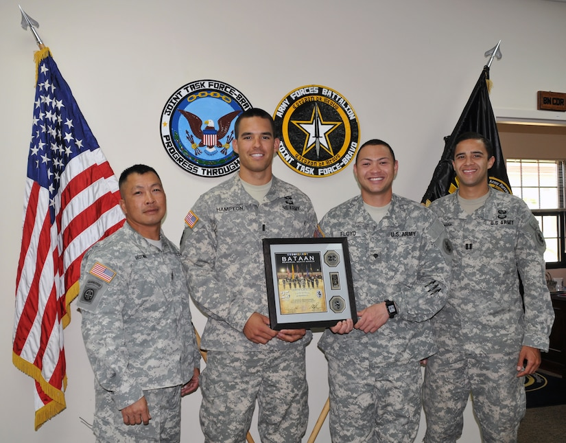 From left to right, U.S. Army 1st Sgt. Thinh Huynh, U.S. Army 1st Lt. Spencer Hampton, U.S. Army Spc. Christopher Floyd, U.S. Army Capt. Bradley Brueggemann.  Four members of Joint Task Force-Bravo's Army Forces Battalion (ARFOR) in Soto Cano Air Base, Honduras, completed the Bataan Memorial Death March on Sunday March 23, 2014 in the White Sands Missile Range, New Mexico.  The Bataan Memorial Death March honors a group of World War II heroes, who defended the islands of Luzon, Corregidor and the harbor defense forts of the Philippines in 1942. After being captured by the Japanese forces, these Army, Army Air Corps, Navy, Marines, and National Guard heroes, survived on half or quarter rations and outdated equipment during the 80 mile march.The soldiers were responsible for the defense of the islands of Luzon, Corregidor and the harbor defense forts of the Philippines.