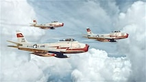 """U.S. Air Force F-86E Sabres """"Little Miss Claire,"""" """"Valerie Jean,"""" and """"Shake, Rattle, & Roll"""" from the New Jersey Air National Guard's 119th Fighter Squadron fly in formation over New Jersey in this digital painting.  The 119th flew the F-86E from 1955 to 1958.  (U.S. Air National Guard digital painting by Tech. Sgt. Matt Hecht)"""