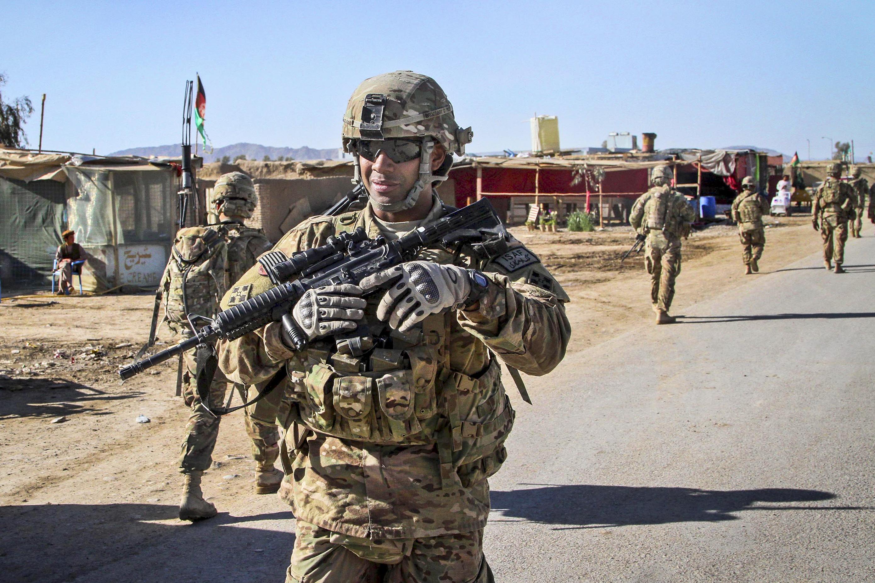US Army Sgt Gilberto Garcia Acevedo Directs A Presence Patrol In Kandahar Province