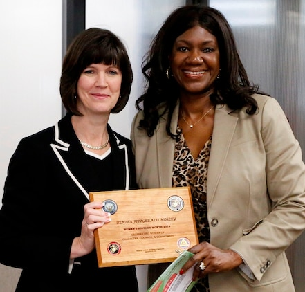 Benita Fitzgerald Mosley (right) accepts a plaque from Deputy Commander for Resource Management Michelle Cresswell-Atkinson after speaking April 1 at a Marine Corps Systems Command Women's History Month presentation. Fitzgerald Mosley was the first African-American woman and just the second American woman to win Olympic gold in the 100-meter hurdles at the 1984 Olympic Games. She now serves as chief of organizational excellence for the U.S. Olympic Committee.