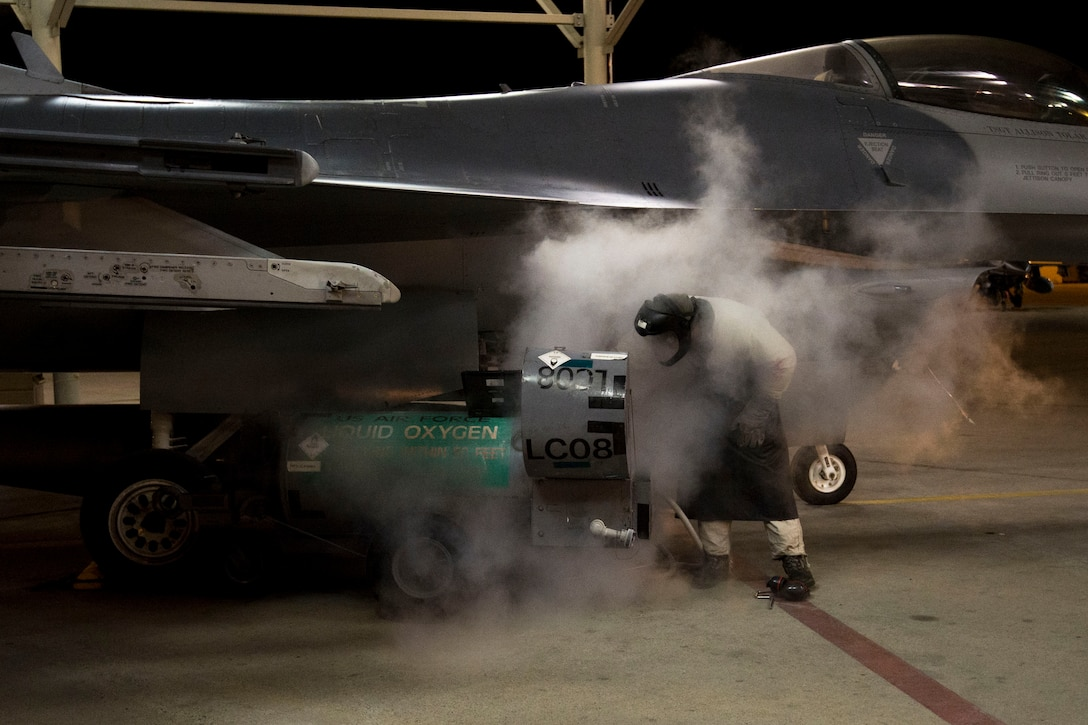 Senior Airman Dylan Stefani injects oxygen into an F-16 Fighting Falcon March 27, 2014, at Hill Air Force Base, Utah. In conjunction with normal maintenance, Airmen assigned to the 388th Fighter Wing participate in Operation Noble Eagle launched after the terrorist attacks on Sept. 11, 2001. Operation Noble Eagle provides rapid-ready fighter aircraft to respond to possible threats. Stefani is assigned to the 388th Component Maintenance Squadron. (U.S. Air Force photo/Airman Taylor Queen)