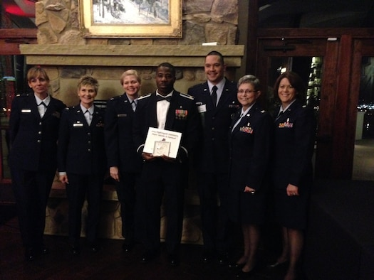Left to right: Maj. Wendy Cole, Col. Kathleen Craver, Capt. Sarah Robbins, Maj. Adeleke Oyemade, Capt. Mario Gonzalez, Col. Judy Gavin and Lt. Col. Lisa Cole pose for a photo during the 2014 Florence Nightingale Award banquet in Colorado Springs March 14. Oyemade won the award for Leadership in Clinical Innovation. (U.S. Air Force/Courtesy Photo)