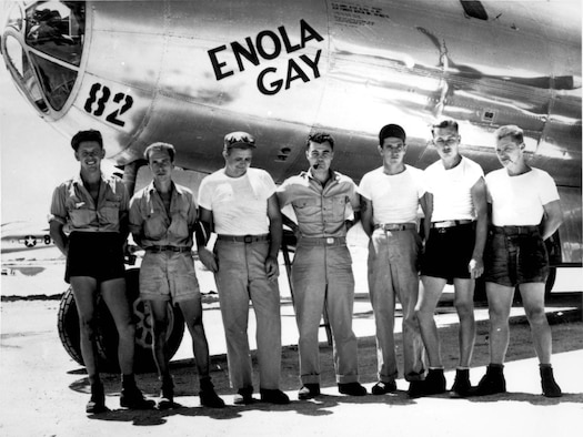 """The crew of the Enola Gay pose in front of the B-29 Superfortress they used to drop """"Little Boy,"""" an atomic bomb, on Hiroshima, Japan, helping to bring an early end to World War II. The Enola Gay was part of the 509th Composite Group, an organization within the 20th Air Force when it had a heavy bombardment mission. Now, the 20th AF maintains and operates the Air Force's ICBM force. (File photo)"""