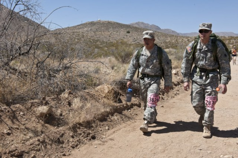 First Sgt. Thinh Huynh (left) and Spc. Christopher Floyd, both assigned to U.S. Army South's Joint Task Force-Bravo, march through the desert during the 25th Bataan Memorial Death March at White Sands Missile Range, New Mexico March 23, 2014. The Bataan Memorial Death March honors a group of World War II heroes, who defended the islands of Luzon, Corregidor and the harbor defense forts of the Philippines in 1942. After being captured by the Japanese forces, these Army, Army Air Corps, Navy, Marines, and National Guard heroes, survived on half or quarter rations and outdated equipment during the 80 mile march.The soldiers were responsible for the defense of the islands of Luzon, Corregidor and the harbor defense forts of the Philippines. (Courtesy photo)