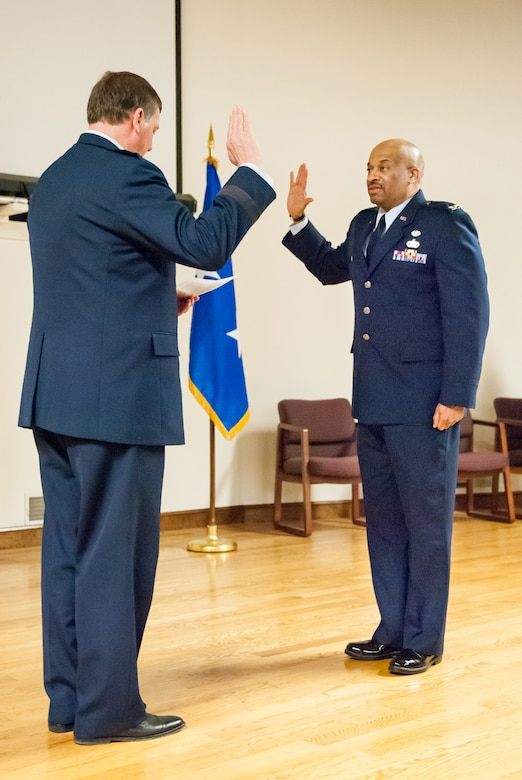 Kentucky's adjutant general, Maj. Gen. Edward Tonini (left), executes the Oath of Office during a ceremony promoting Charles Walker to the rank of colonel at the Kentucky Air National Guard Base in Louisville, Ky., March 22, 2014. Walker, staff judge advocate for Joint Forces Headquarters Air Component, Kentucky National Guard, is the first African-American to be promoted to the rank of colonel in Kentucky Air Guard history. (U.S. Air National Guard photos by Staff Sgt. Vicky Spesard)