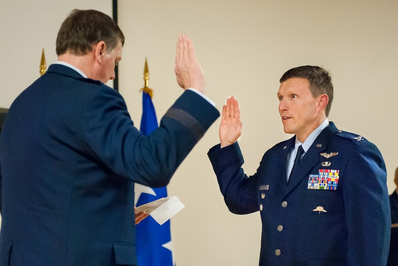 Kentucky's adjutant general, Maj. Gen. Edward Tonini (left), executes the Oath of Office during a ceremony promoting Jeffrey Wilkinson to the rank of colonel at the Kentucky Air National Guard Base in Louisville, Ky., March 22, 2014. Wilkinson, vice commander of the 123rd Airlift Wing, is the first special tactics officer to be promoted to the rank of colonel in Kentucky Air Guard history. (U.S. Air National Guard photos by Staff Sgt. Vicky Spesard)