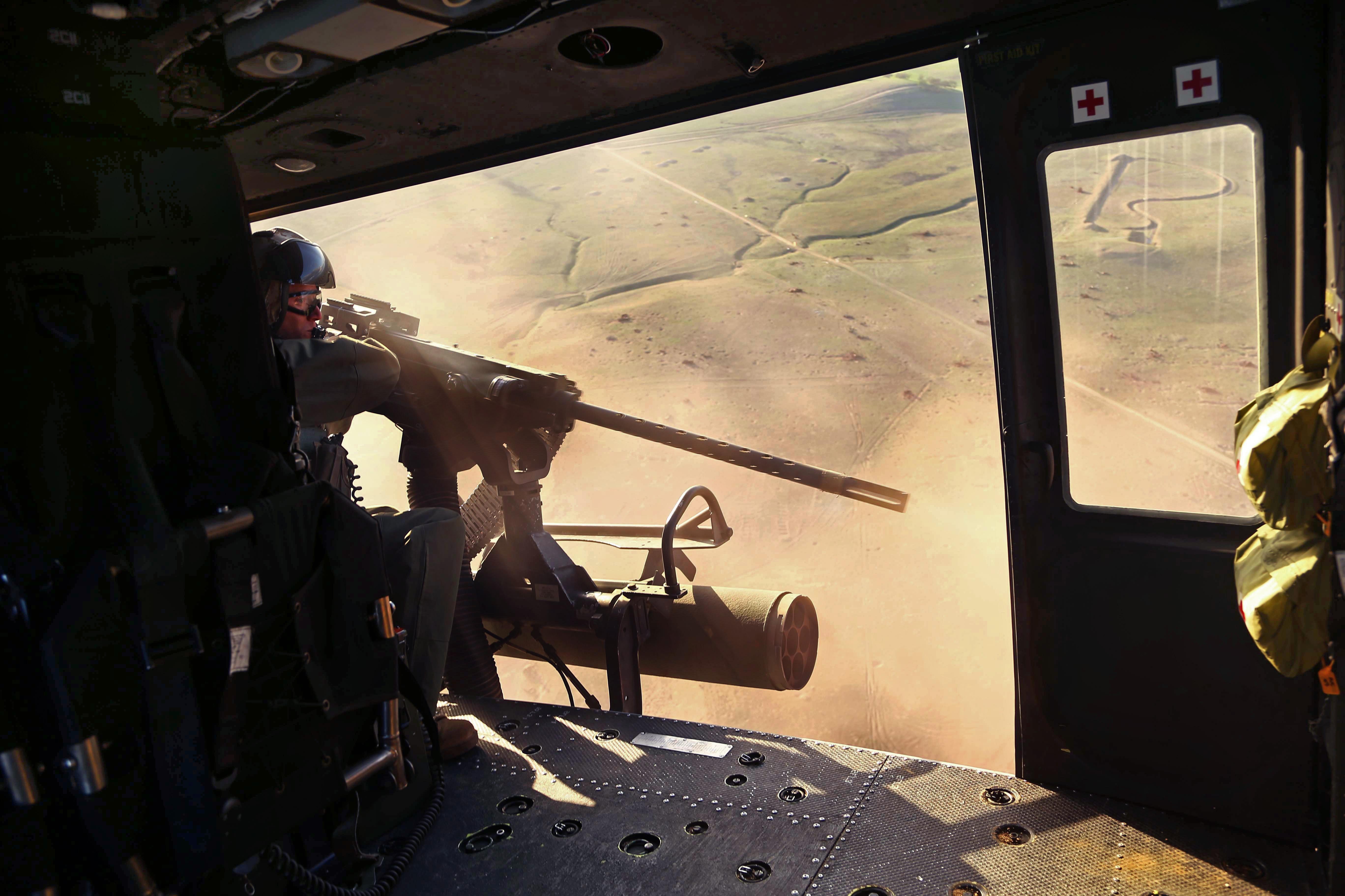 Marine Corps Gunnery Sgt  Kenneth T  Deal fires a GAU-21  50-caliber