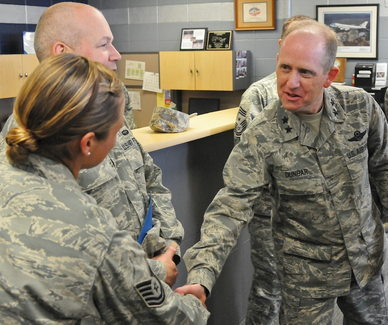 Maj. Gen. Donald P. Dunbar, the adjutant general of Wisconsin greets Tech. Sgt. Kitrina Vargas of the 128th Air Refueling Wing Small Air Terminal, Milwaukee, on a planned tour during the unit training assembly April 6, 2014.
